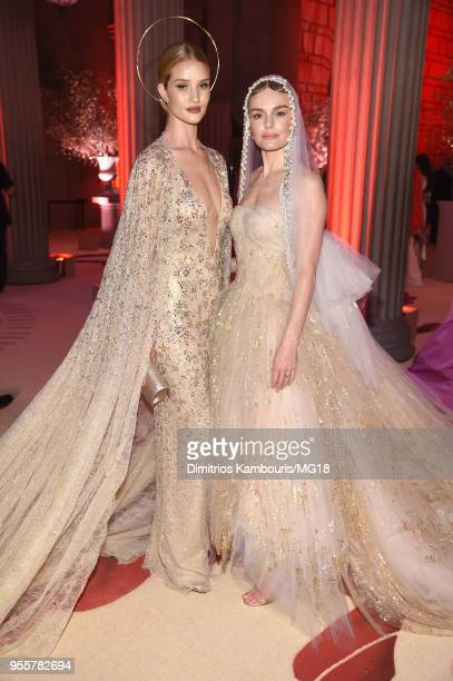 Rosie Huntington-Whiteley and Kate Bosworth attend the Heavenly Bodies: Fashion & The Catholic Imagination Costume Institute Gala at The Metropolitan...