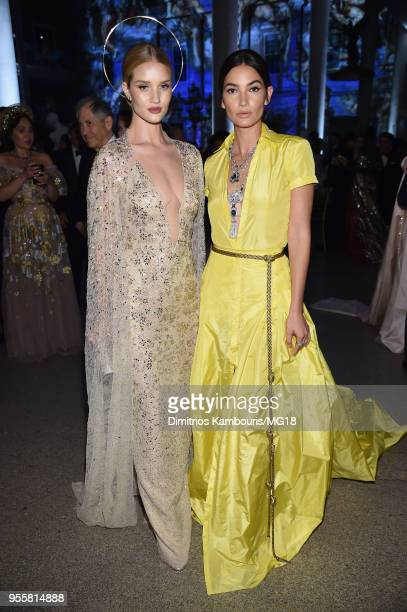 Rosie Huntington-Whiteley and Lily Aldridge attend the Heavenly Bodies: Fashion & The Catholic Imagination Costume Institute Gala at The Metropolitan...