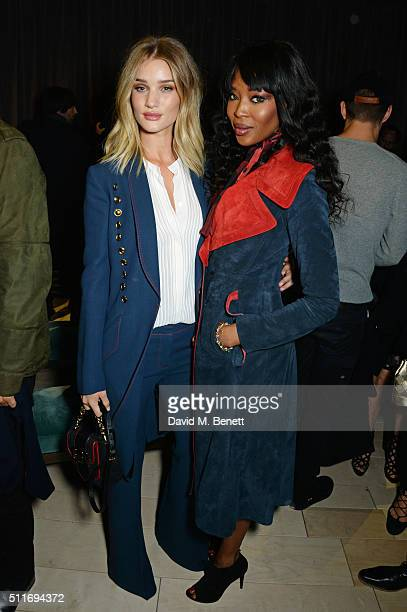Rosie HuntingtonWhiteley and Naomi Campbell wearing Burberry at the Burberry Womenswear February 2016 Show at Kensington Gardens on February 22 2016...