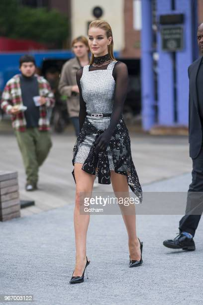 Rosie HuntingtonWhiteley arrives at the Alexander Wang resort fashion show at Pier 17 on June 3 2018 in New York City