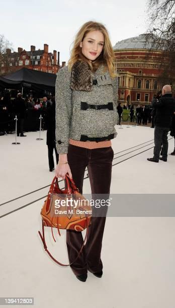 Rosie HuntingtonWhiteley arrives at the Burberry Autumn Winter 2012 Womenswear Show during London Fashion Week at Kensington Gardens on February 20...