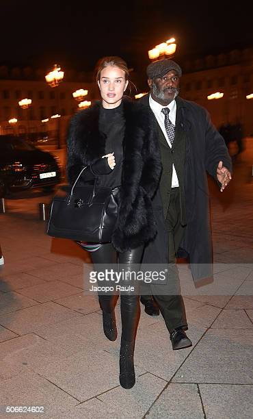 Rosie HuntingtonWhiteley arrives at the Versace fashion show as part of Paris Fashion Week Haute Couture Spring/Summer 2016 on January 24 2016 in...