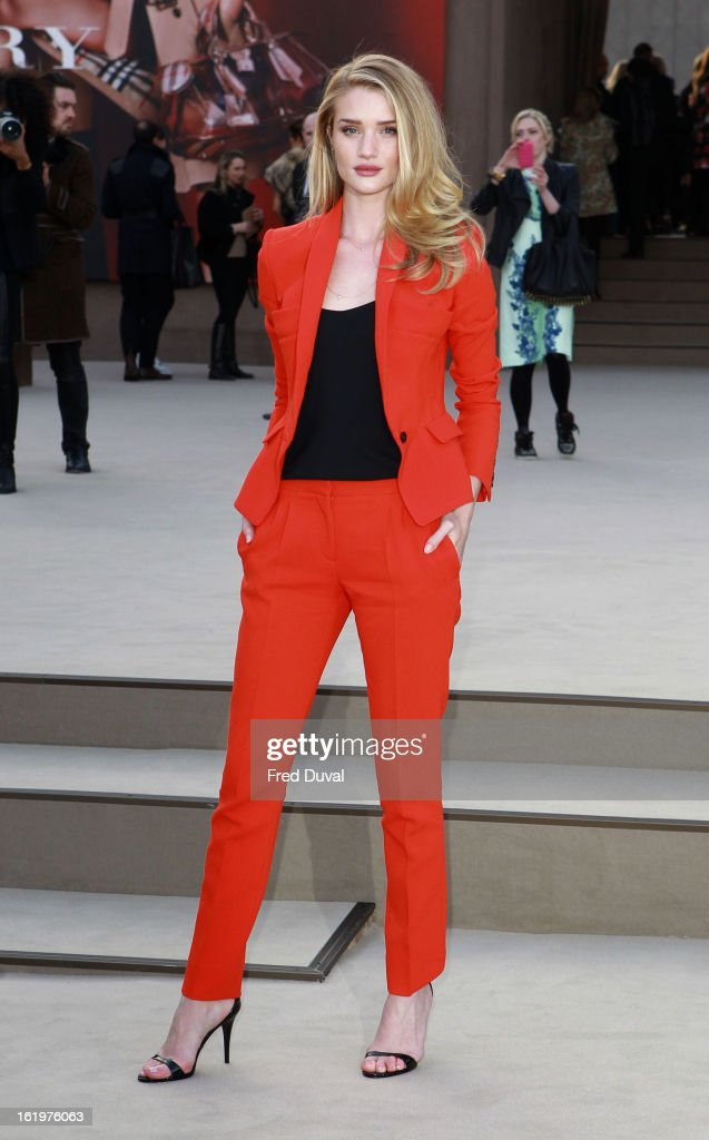 Rosie Huntington-Whiteley arrives to attend the Burberry Prorsum show during London Fashion Week Fall/Winter 2013/14 at on February 18, 2013 in London, England.
