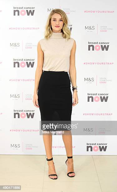 Rosie Huntington-Whiteley attends a photocall to launch a new lingerie range in partnership with Breast Cancer Awareness at Marks & Spencer Marble...