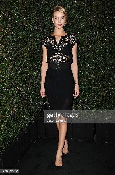 Rosie HuntingtonWhiteley attends the Chanel and Charles Finch preOscar dinner at Madeo Restaurant on March 1 2014 in Los Angeles California