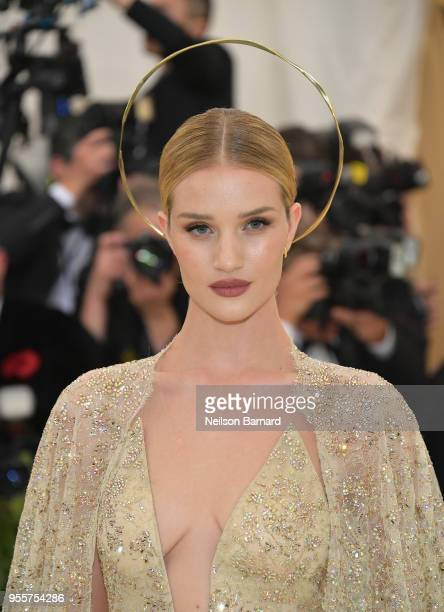 Rosie HuntingtonWhiteley attends the Heavenly Bodies Fashion The Catholic Imagination Costume Institute Gala at The Metropolitan Museum of Art on May...