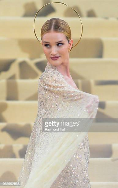 Rosie Huntington-Whiteley attends the Heavenly Bodies: Fashion & The Catholic Imagination Costume Institute Gala at The Metropolitan Museum of Art at...