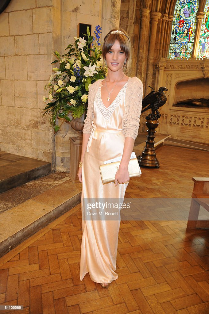 Rosie Huntington-Whiteley attends the wedding of Leah Wood and Jack MacDonald at Southwark Cathedral on June 21, 2008 in London, England.