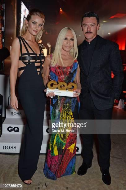 Rosie HuntingtonWhiteley Donatella Versace winner of the Designer of the Year award and Luke Evans attend the GQ Men of the Year Awards 2018 in...