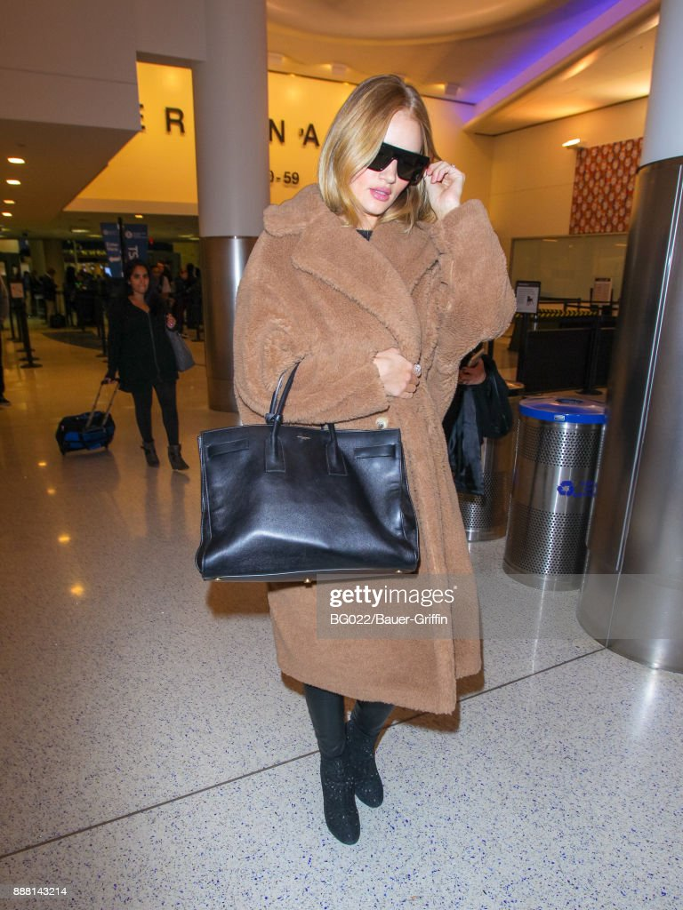 Rosie Huntington-Whiteley is seen at Los Angeles International Airport on December 07, 2017 in Los Angeles, California.