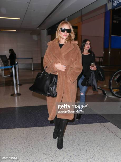 Rosie HuntingtonWhiteley is seen at Los Angeles International Airport on December 07 2017 in Los Angeles California