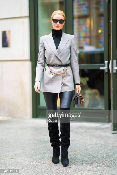 Rosie HuntingtonWhiteley is seen wearing a Blaze Milano blazer Saint Laurent boots with a Fendi handbag in SoHo on April 4 2018 in New York City