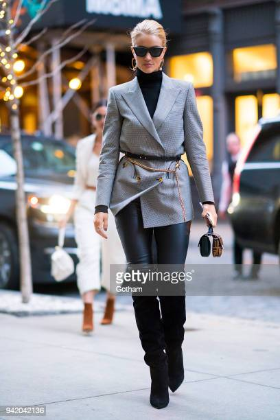 Rosie HuntingtonWhiteley is seen wearing a Blaze Milano blazer Saint Laurent boots with a Fendi handbag in SoHo on April 4 2018 in New York City