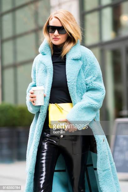 Rosie HuntingtonWhiteley is seen wearing a Burberry coat RTA pants with a Loweve handbag in SoHo on February 9 2018 in New York City