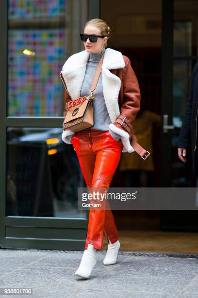 Rosie HuntingtonWhiteley is seen wearing an Acne jacket Givenchy pants and Chloe sweater with a Fendi handbag in SoHo on March 27 2018 in New York...