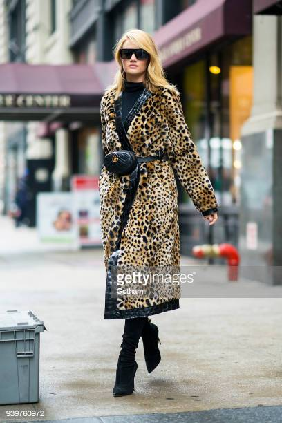 Rosie Huntington-Whiteley is seen wearing an Attica coat with a Gucci fanny pack in Chelsea on March 29, 2018 in New York City.