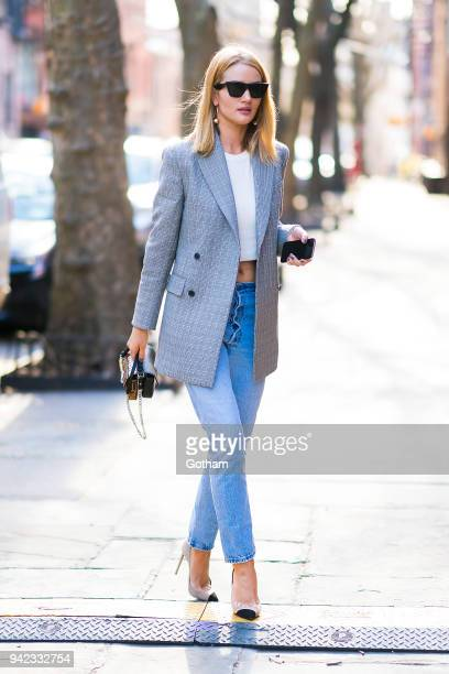 Rosie HuntingtonWhiteley is seen wearing Calvin Klein blazer Re/done jeans with a Fendi handbag in SoHo on April 5 2018 in New York City