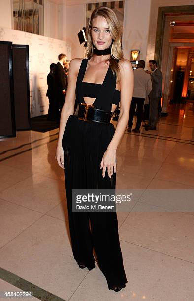 Rosie HuntingtonWhiteley poses at the Harper's Bazaar Women Of The Year awards 2014 at Claridge's Hotel on November 4 2014 in London England