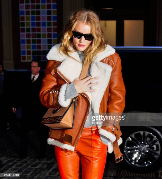 Rosie HuntingtonWhiteley wears an orange jacket and pants on March 27 2018 in New York City