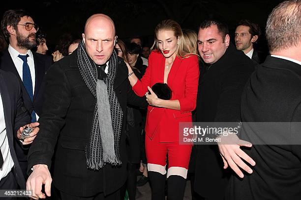 Rosie HuntingtonWhitley attends Playboy's 60th anniversary issue party hosted by Marc Jacobs and Kate Moss at The Playboy Club on December 2 2013 in...