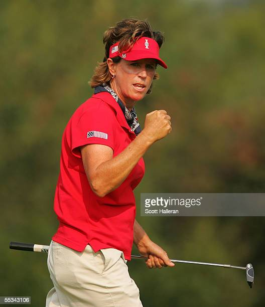 Rosie Jones of the USA celebrates a birdie on the 12th hole during the Saturday afternoon four-ball matches at the Solheim Cup at Crooked Stick Golf...