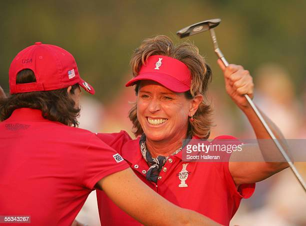Rosie Jones of the USA celebrates a birdie on the 18th hole with teammate Juli Inkster during the Saturday afternoon four-ball matches at the Solheim...
