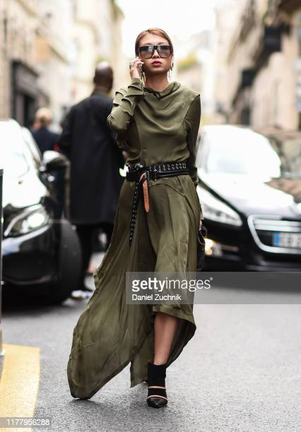 Rosie Lai is seen wearing a dark green dress with black belt outside the Thom Browne show during Paris Fashion Week SS20 on September 29 2019 in...