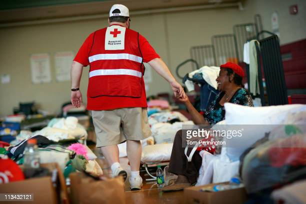 Rosie Marie Spann interacts with a Red Cross volunteer at a Red Cross Shelter on May 2 2011 in Tuscaloosa Alabama The shelter is housing more than...