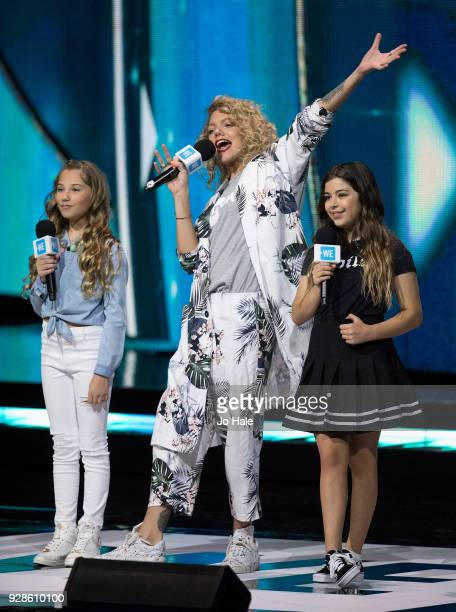 Rosie McClelland Becca Dudley and Sophie Grace on stage at We Day UK at Wembley Arena on March 7 2018 in London England