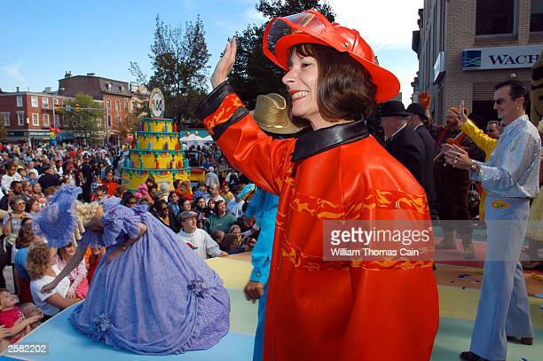 Rosie McFetridge waves to the crowd as she portrays the Crayola Hall of Fame color Orange Red which was retired in 1990 during Crayola Crayon's 100th...