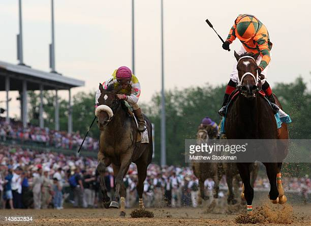 Rosie Napravnik celebrates atop Believe You Can after winning the 138th running of the Kentucky Oaks in front of Grace Hall ridden by Javier...