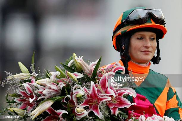 Rosie Napravnik sits atop Believe You Can with the Lilly's after winning the 138th running of the Kentucky Oaks at Churchill Downs on May 4 2012 in...