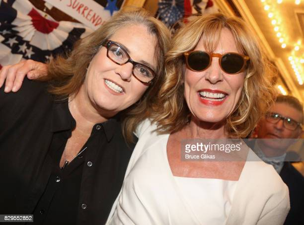 Rosie O'Donnell and Christine Lahti pose at the opening night arrivals for Michael Moore's 'The Terms Of My Surrender' on Broadway at The Belasco...