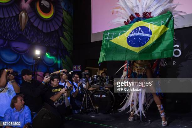 Rosie Oliveira from Amazonas holds a Brazilian national flag with an inscription reading Temer out during the Miss Bumbum Brazil 2017 pageant in Sao...
