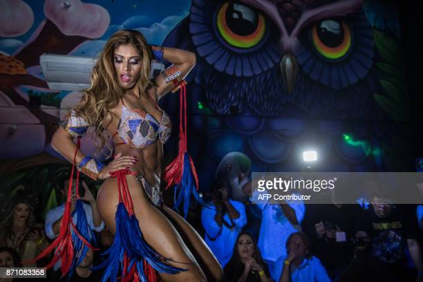 Rosie Oliveira from Amazonas poses on the catwalk during the Miss Bumbum Brazil 2017 pageant in Sao Paulo on November 07 2017 Fifteen candidates are...