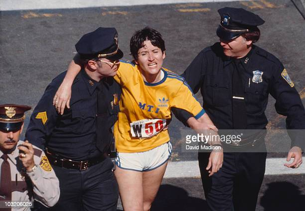 Rosie Ruiz is shown moments after crossing the finish line as the apparent women's race winner of the 84th Boston Marathon on April 21 1980 in Boston...