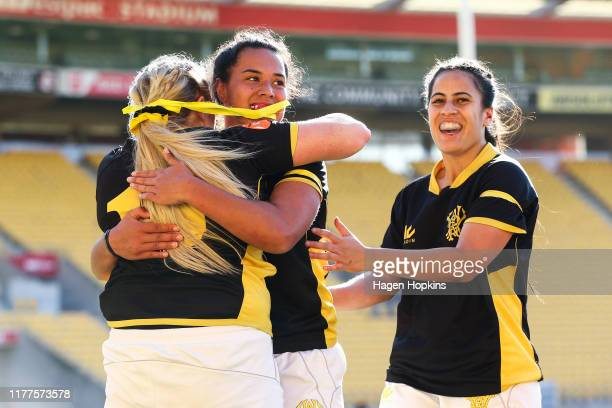 Rosie Stirling of Wellington celebrates with Amanda Rasch and Fa'asua Makisi after scoring a try during the round 5 Farah Palmer Cup match between...