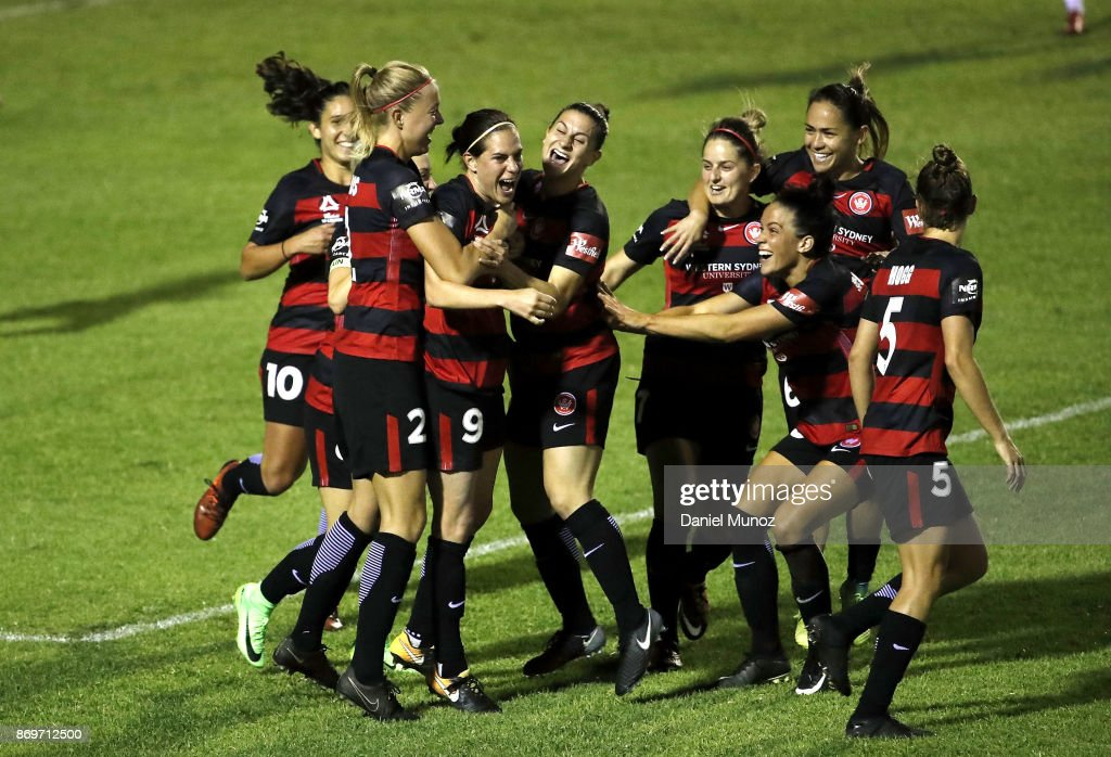 Rosie Sutton of the Wanderers (3rd left) celebrates with teammates after scoring during the round two W-League match between the Western Wanderers and Adelaide United at Marconi Stadium on November 3, 2017 in Sydney, Australia.