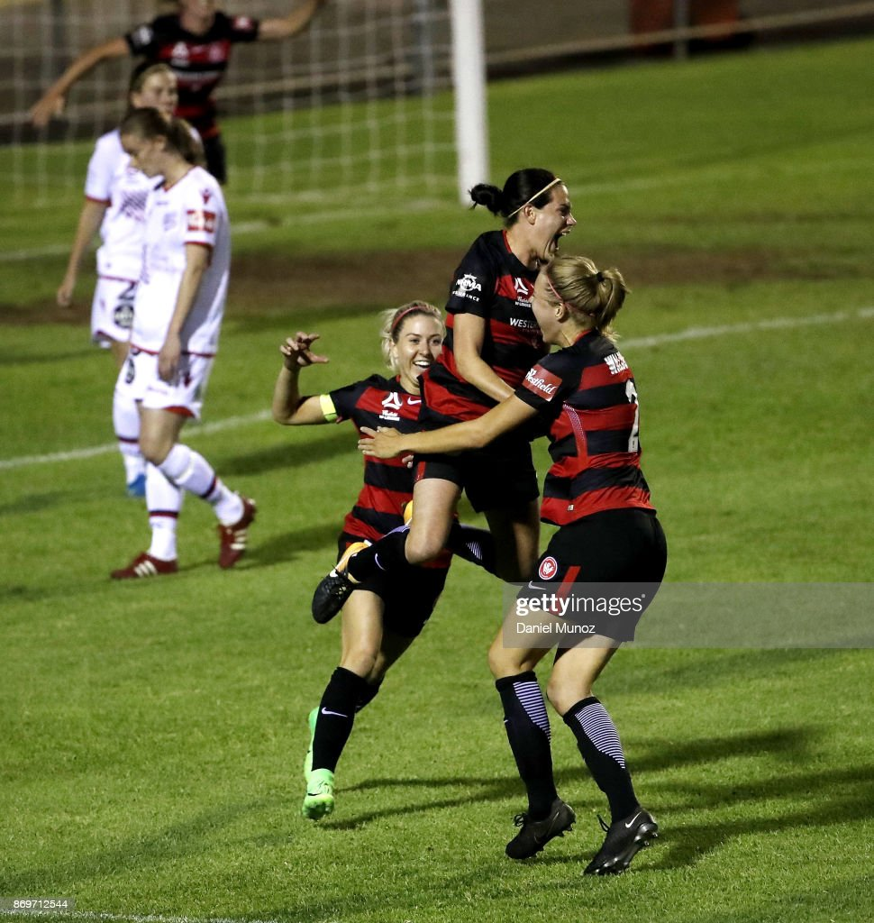 Rosie Sutton of the Wanderers (centre) celebrates with teammates after scoring during the round two W-League match between the Western Wanderers and Adelaide United at Marconi Stadium on November 3, 2017 in Sydney, Australia.