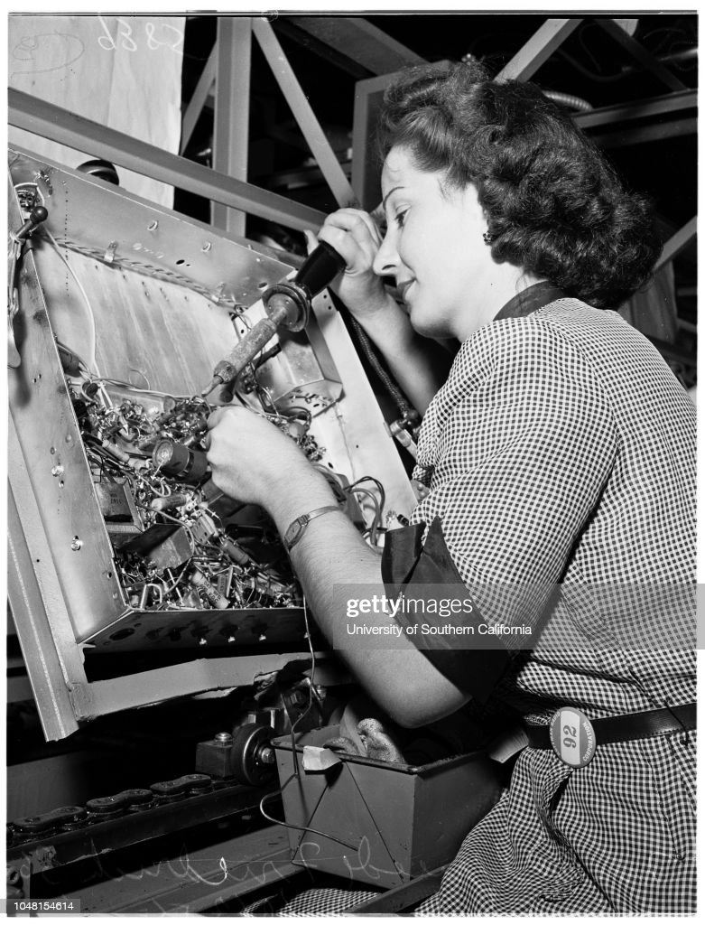 Rosie the riveter (electrical assembly line, Hoffman Radio Corporation), 1951 : News Photo