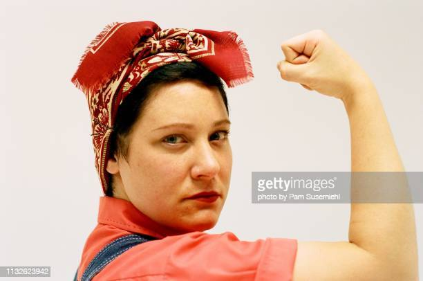 rosie the riveter inspired studio shot - rosie the riveter stock pictures, royalty-free photos & images