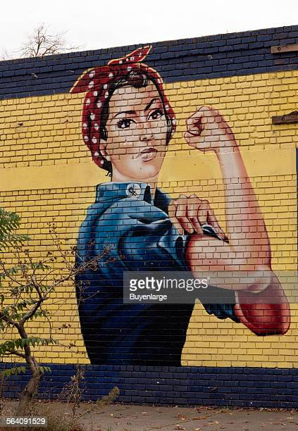 Rosie the Riveter mural on an abandoned building in Sacramento California