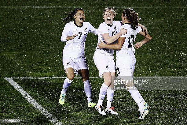 Rosie White of New Zealand celebrates with Ali Riley of New Zealand and Betsy Hassett of New Zealand after scoring a goal during the Women's...