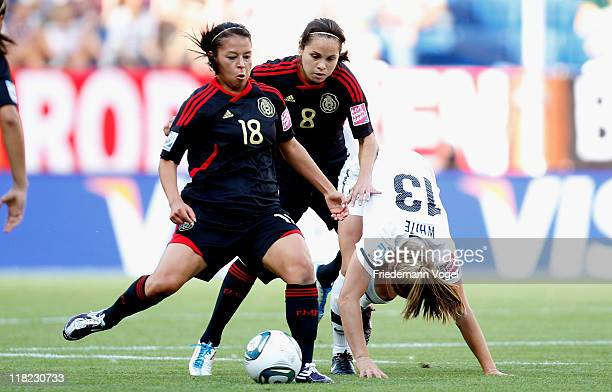 Rosie White of New Zealand Veronica Perez and Guadalupe Worbis of Mexico battle for the ball during the FIFA Women's World Cup 2011 Group B match...