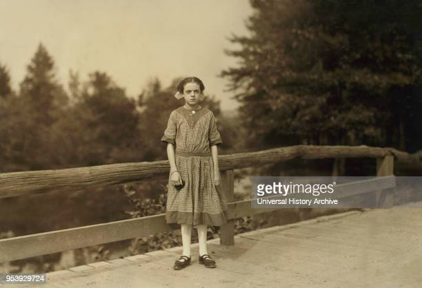 Rosina Goyette 12 years old but said she is 14 FullLength Portrait Works as Doffer and Spinner at Spring Village Mills Winchendon Massachusetts USA...