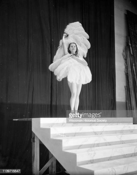 Rosita Carmen, burlesque dancer, performing with feather fans on the stage of the Orpheum Theatre, Madison, Wisconsin, September 28, 1933.