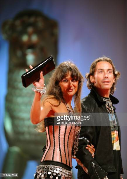 Rosita Celentano and her boyfriend Soldano Kunz D'Asburgo pose before the screening of the movie Yuppi Du at the 65th Venice International Film...