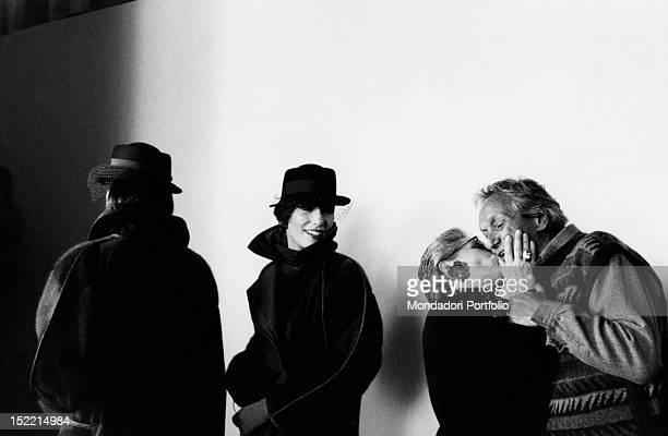 Rosita Jelmini kissing her husband, the Yugoslav-born Italian stylist Ottavio Missoni in the backstage of a fashion show. Milan, March 1984
