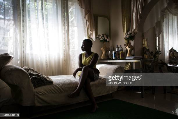 Rosita Mabuiango who 17 years ago was born in a tree during floods in Mozambique in 2000 sits in her lounge on February 11 2017 in Maputo The images...