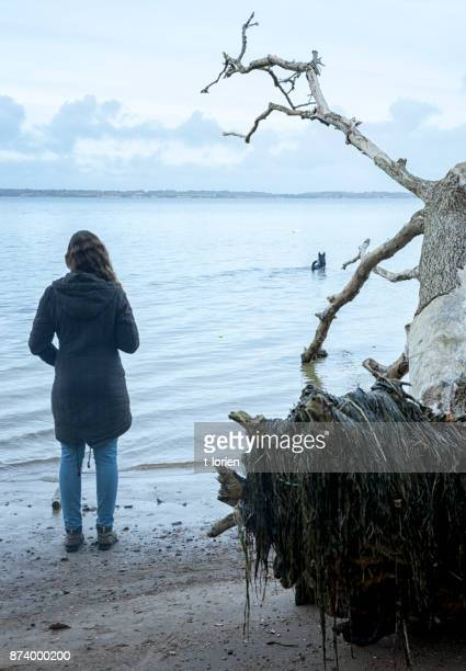 young woman looking at water while